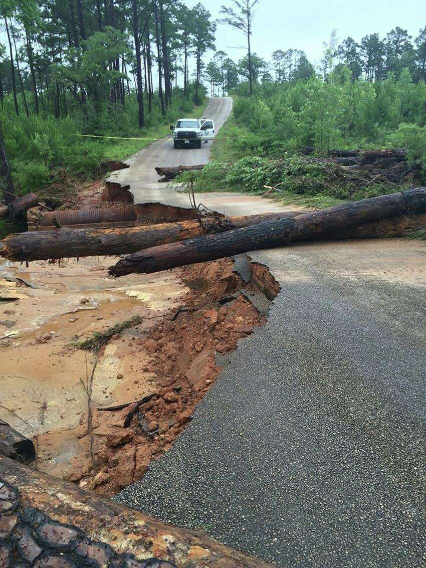 Flood damage on the park road between Bastrop and Buescher State Parks. The parks are open, though some areas are closed due to flood damage. Park Road 1C is closed.