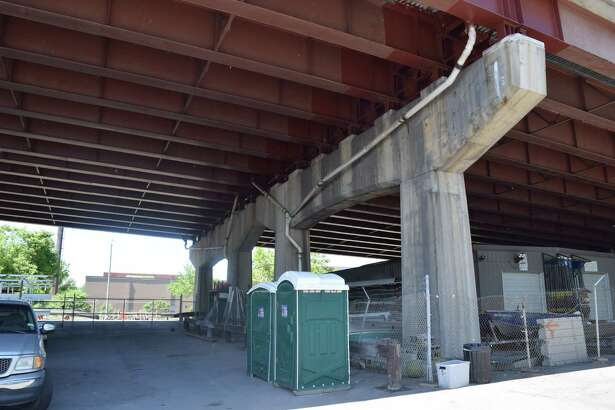 Portable toilets under the 787 overpass at the Port of Albany boating dock, several hundred yards from the Corning Preserve.