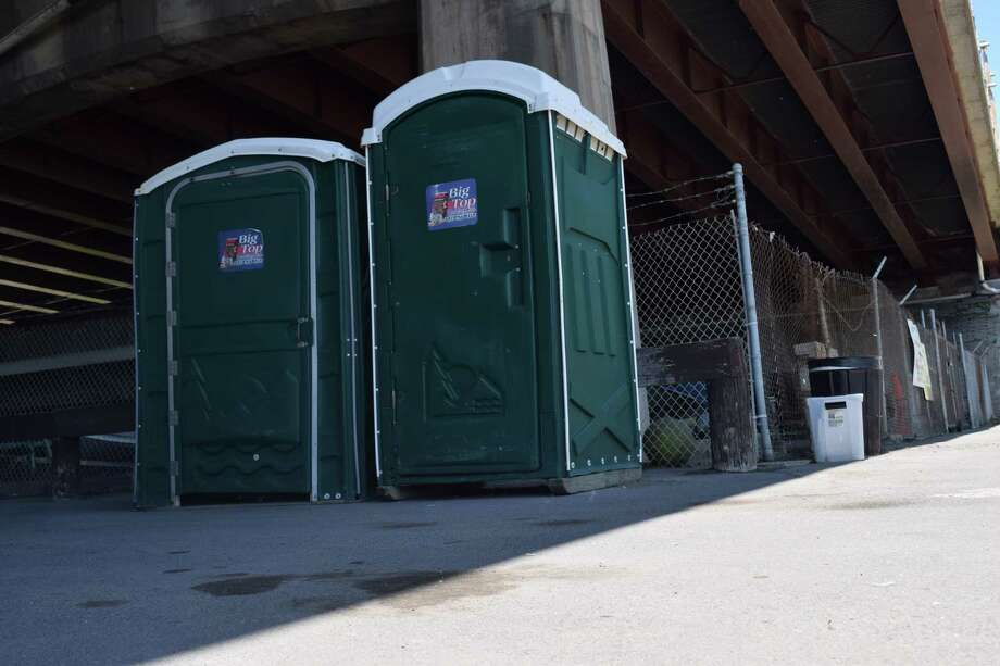 A video shows portable toilets chasing people through the streets of Moscow.
