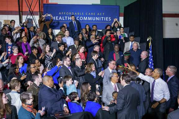 President Barack Obama greets the crowd after speaking about the Affordable Care Act at the United Community Center in Milwaukee, March 3, 2016. Obama's trip is intended to be a reward for Milwaukee, which won a nationwide competition for enrollment of previously uninsured residents in private health insurance under the Affordable Care Act. (Zach Gibson/The New York Times)