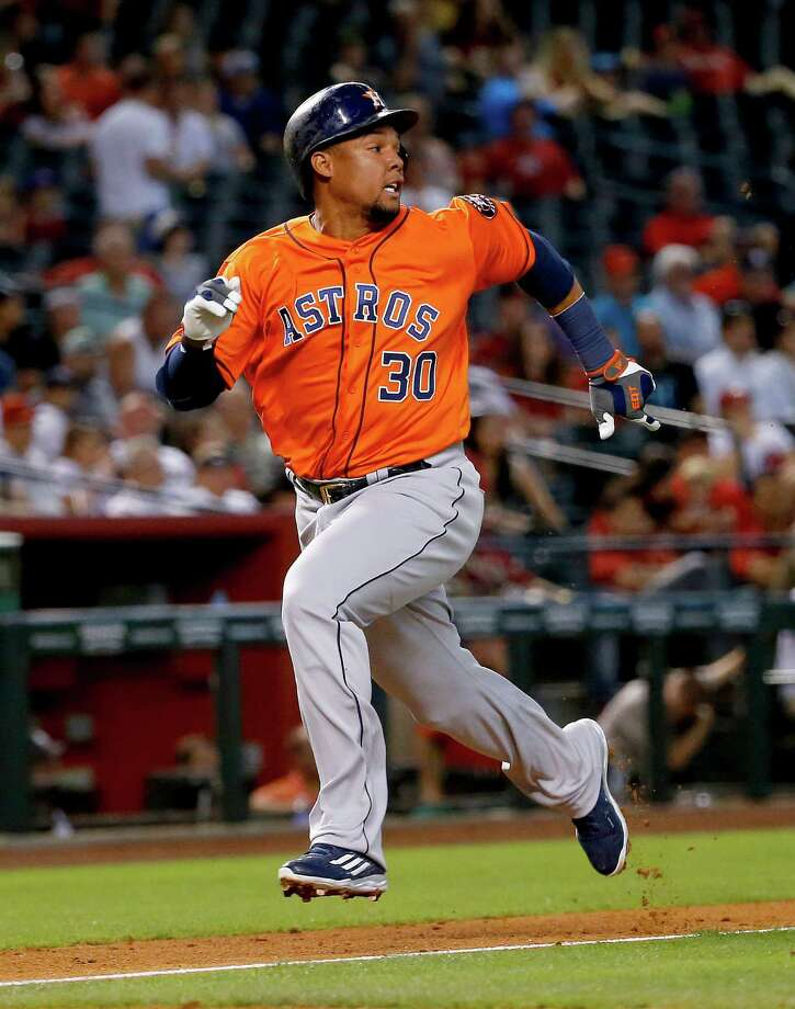 Houston Astros center fielder Carlos Gomez (30) scores on a base hit by teammate George Springer against the Arizona Diamondbacks during the fourth inning of a baseball game, Tuesday, May 31, 2016, in Phoenix. (AP Photo/Matt York) Photo: Matt York, Associated Press / AP