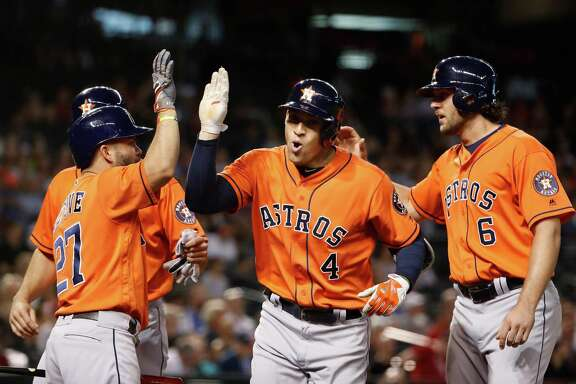 PHOENIX, AZ - MAY 31:  George Springer #4 of the Houston Astros is congratulated by Jose Altuve #27, Jake Marisnick #6 and Lance McCullers #43 after Springer hit a three-run home run against the Arizona Diamondbacks during the second inning of the MLB game at Chase Field on May 31, 2016 in Phoenix, Arizona.