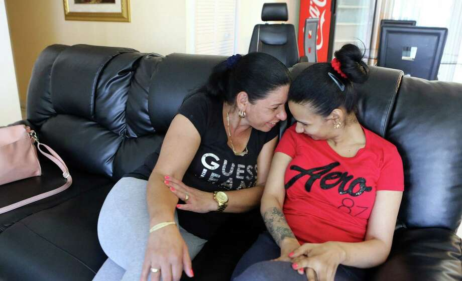 Mariela Diaz, left, shares a moment with her daughter, Linda Perez, 21, on May 20, 2016. When she was 18, Perez underwent a plastic surgery procedure at Coral Gables Cosmetic Center that led to her being in a coma for two weeks and brain damage. Photo: Hector Gabino /TNS / Miami Herald