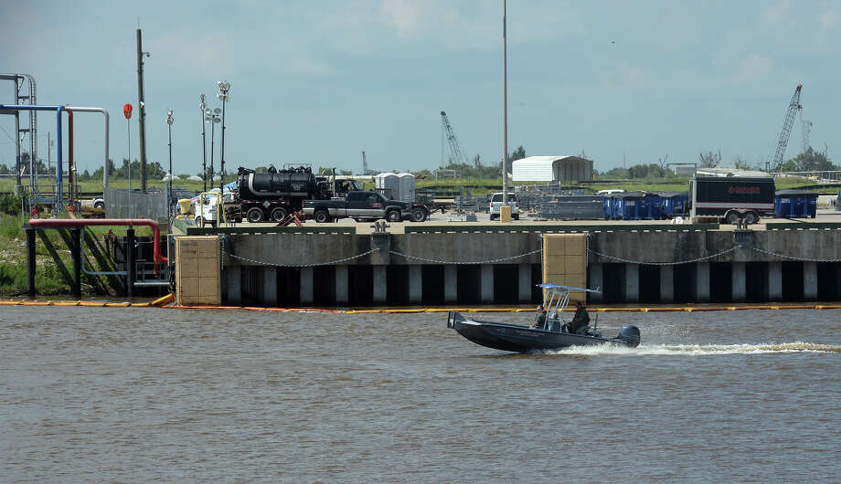 Booms to collect the 900 gallons of oil spilt into the Port of Beaumont can be seen along the waters edge on Tuesday. According to the U.S. Coast Guard, most of the slick has been collected or evaporated. Photo taken Tuesday, May 31, 2016 Guiseppe Barranco/The Enterprise Photo: Guiseppe Barranco, Photo Editor