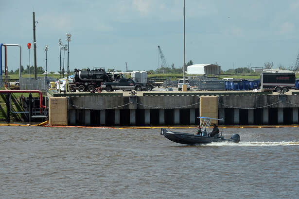 Booms to collect the 900 gallons of oil spilt into the Port of Beaumont can be seen along the waters edge on Tuesday. According to the U.S. Coast Guard, most of the slick has been collected or evaporated. Photo taken Tuesday, May 31, 2016 Guiseppe Barranco/The Enterprise