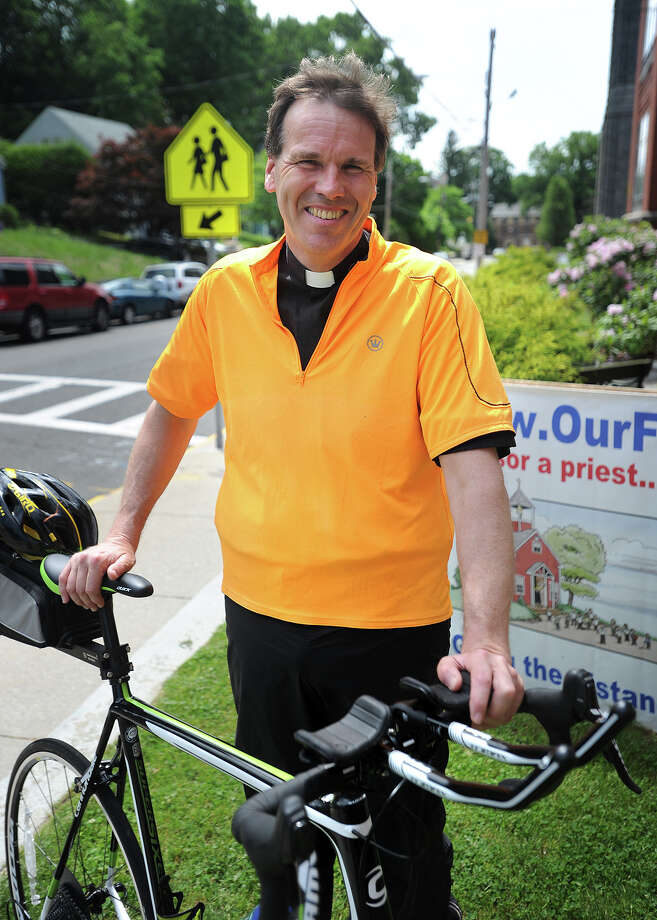 The Rev. James Sullivan of Assumption Church in Ansonia leaves Wednesday morning on a four day 372-mile bicycle ride to Montreal, Canada as a fundraiser for Assumption School. Photo: Brian A. Pounds / Hearst Connecticut Media / Connecticut Post