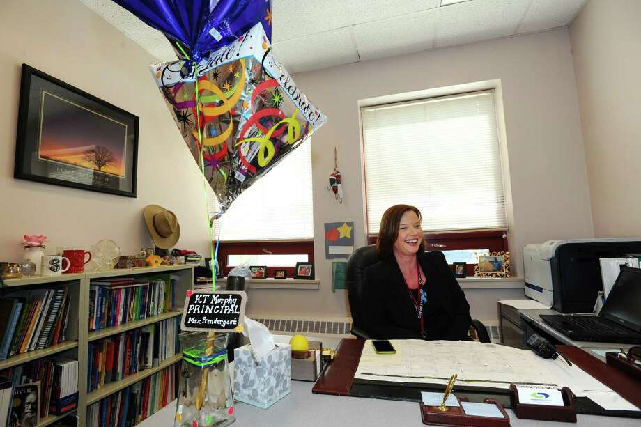 New K.T. Murphy Elementary School Principal Sherri Prendergast smiles next to congratulations balloons at her desk inside Westover Magnet Elementary School on Tuesday. Photo: Michael Cummo / Hearst Connecticut Media / Stamford Advocate