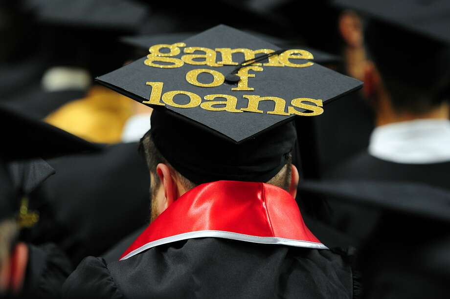 """A graduate's cap is decorated with the words """"Game of Loans,"""" a play on the popular TV show Game of Thrones during Southern Connecticut State University's Commencement 2016 Undergraduate Ceremony at the Arena at Harbor Yard in Bridgeport, Conn., on Friday May 20. Photo: Christian Abraham, Hearst Connecticut Media"""
