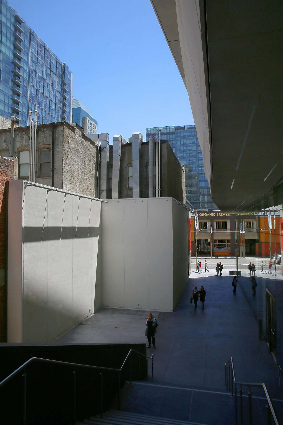The Howard Street entrance of SFMOMA has an alley on the north side seen on Monday, May 30, 2016 in San Francisco, Calif. The SFMOMA building (right) heightens our impressions of its surroundings.