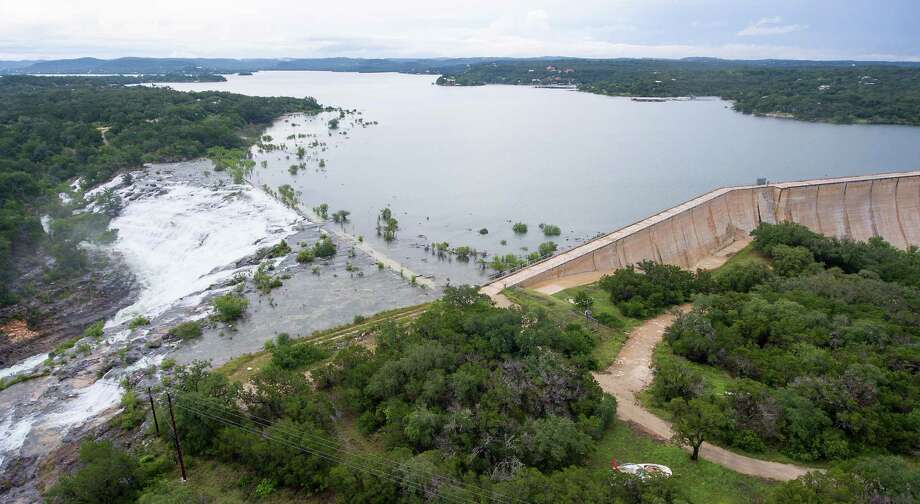 Water flows over the Medina Lake spillway May 31, 2016 as seen in an aerial image taken with a remote control quadcopter. On May 31, 2015 the lake was 51.5 percent full according to data from the Texas Water Development Board. Instantaneous water readings as of 6 p.m. Tuesday show the lake to be .9 feet into flood stage and that it has been rising for the last 48 hours. Photo: William Luther, San Antonio Express-News / © 2016 San Antonio Express-News
