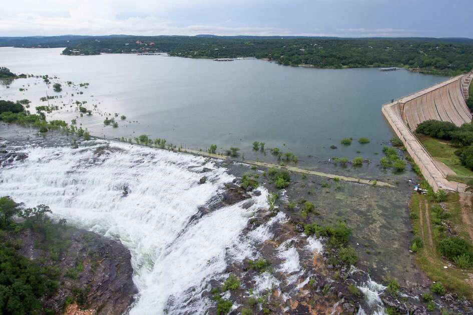 Water flows over the Medina Lake spillway May 31, 2016 as seen in an aerial image taken with a remote control quadcopter. On May 31, 2015 the lake was 51.5 percent full according to data from the Texas Water Development Board. Instantaneous water readings as of 6 p.m. Tuesday show the lake to be .9 feet into flood stage and that it has been rising for the last 48 hours.