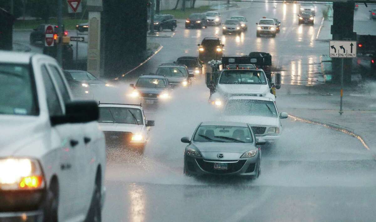 Drivers deal with rain-soaked roads along Wurzbach Road as a downpour drenched the city on Tuesday, May 31, 2016.