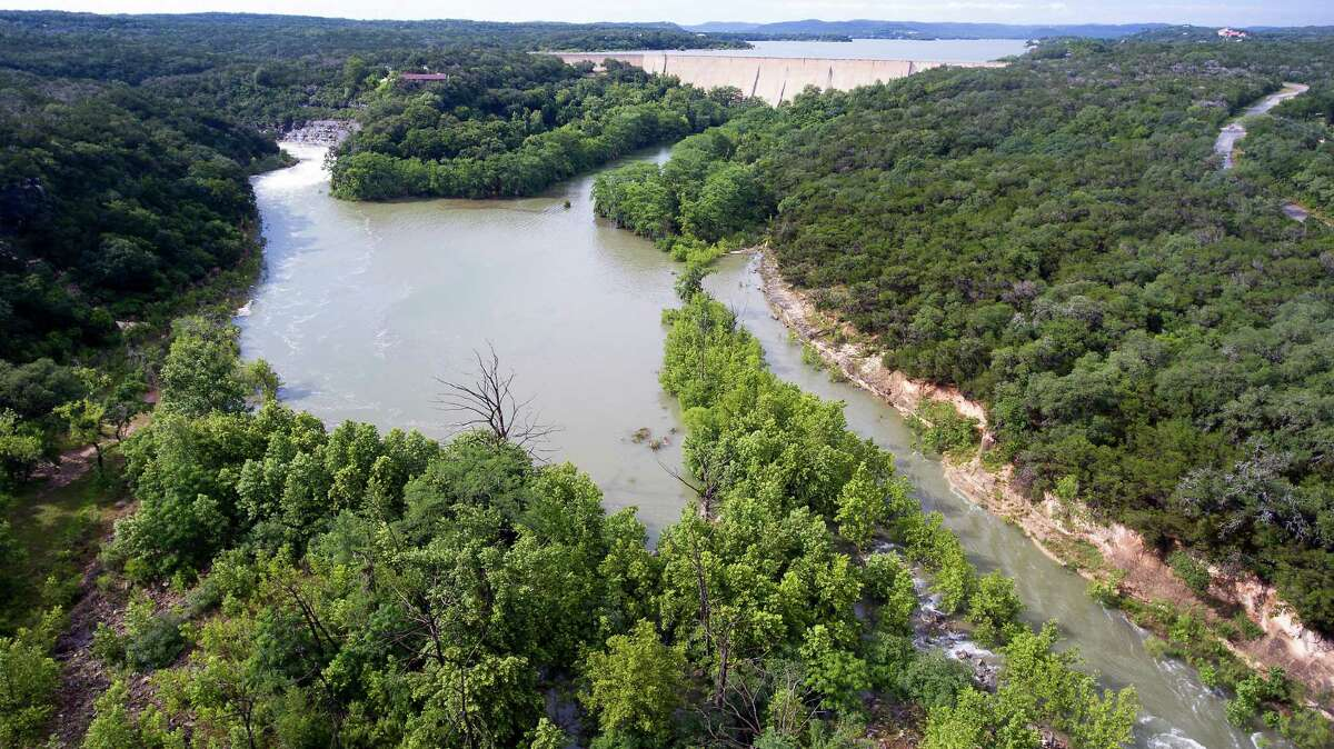 Water flowing over the Medina Lake spillway, left, May 31, 2016 fills the area below the dam that becomes Diversion Lake as seen in an aerial image taken with a remote control quadcopter. On May 31, 2015 Medina Lake was 51.5 percent full according to data from the Texas Water Development Board. Instantaneous water readings as of 6 p.m. Tuesday show the lake to be .9 feet into flood stage and that it has been rising for the last 48 hours.
