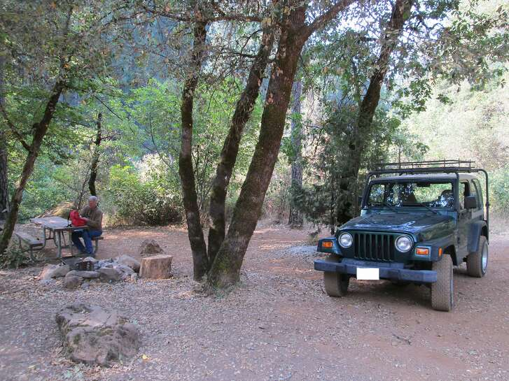 Rambob and his Jeep at campsite in remote Shasta-Trinity National Forest, first-come, first-served sites like these can provide relief for 4th of July Campers