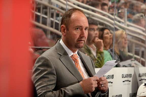 GLENDALE, AZ - MARCH 17:  Head coach Peter DeBoer of the San Jose Sharks looks over some notes while on the bench during a game against the Arizona Coyotes at Gila River Arena on March 17, 2016 in Glendale, Arizona.  (Photo by Norm Hall/NHLI via Getty Images)