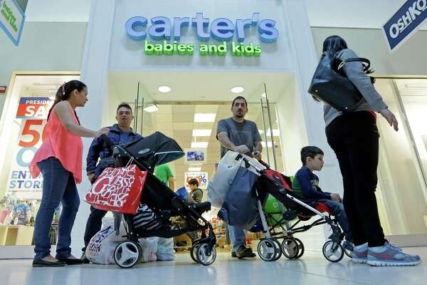 Shoppers go for an outing in a Miami mall. Spending on goods such as clothing and food expanded a solid 1.4 percent in April, the Commerce Department says.
