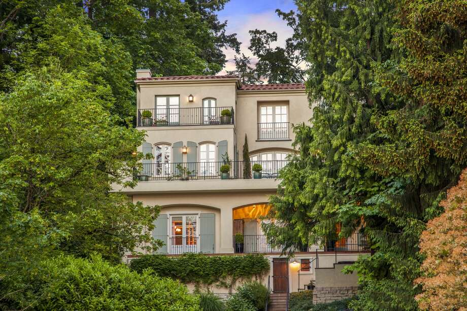 """This home at 5203 82nd Ave. S.E. is listed for $6.85 million. Known as """"Maison des Volets"""" (House of Shutters), the home is meant to evoke a lavish French chateau.  The 6,000-square-foot, six bedroom, 5½-bathroom home sits on just under half an acre with 61 feet of waterfront. The property features manicured and mature gardens, a lake house that doubles as a studio and a dock with year-round moorage.  You can see the full listing here. Photo: Clarity Northwest"""