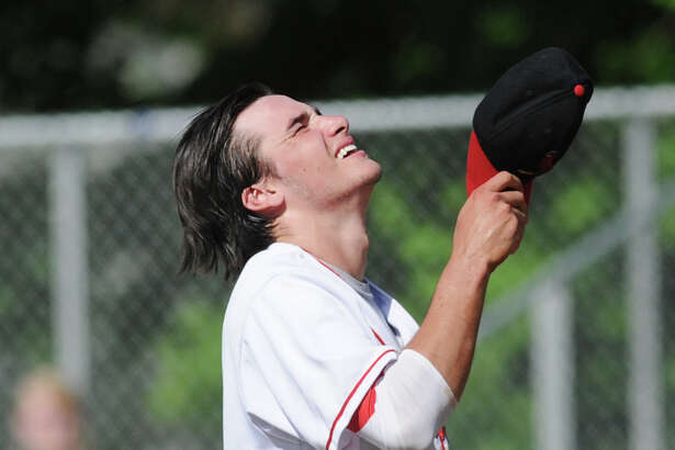 Greenwich pitcher Connor Langan reacts during the CIAC high school baseball playoff game that he and his team lost to Bristol Central High School at Greenwich, Conn., Tuesday, May 31, 2016. Bristol Central defeated Greenwich 3-0 to advance in the tournament.
