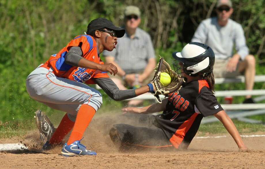 Danbury's Davonna Spruill (11) tags Stamford's Allie Buzzeo (7) at third in the State Class LL softball game between Stamford and Danbury high schools, on Tuesday afternoon, May 31, 2016, at Danbury High School, Danbury, Conn. Buzzeo was called safe at third. Photo: H John Voorhees III / Hearst Connecticut Media / The News-Times