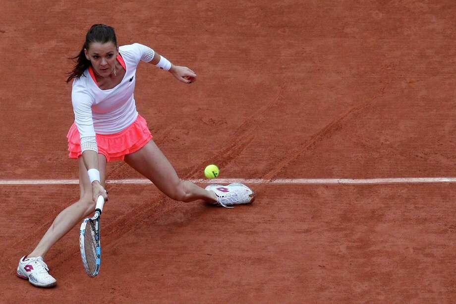 Second-seeded Agnieszka Radwanska had trouble with the slippery court in her loss to Tsvetana Pironkova. Photo: Christophe Ena, STF / AP