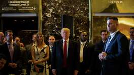 Donald Trump arrives for the news conference at Trump Tower, where he blasted the media.