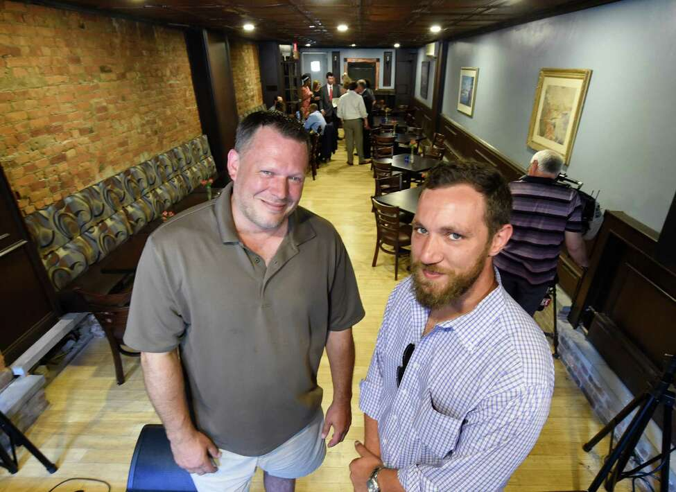 Savoy Taproom owner Jason Pierce, left, and Daniel Atkins stand in the renovated dining room of the Savoy restaurant in 2016 in Albany, N.Y. Pierce has expressed concerns about how those struggling with homelessness, addiction and mental illness who come to his bar can be helped. (Skip Dickstein/Times Union)