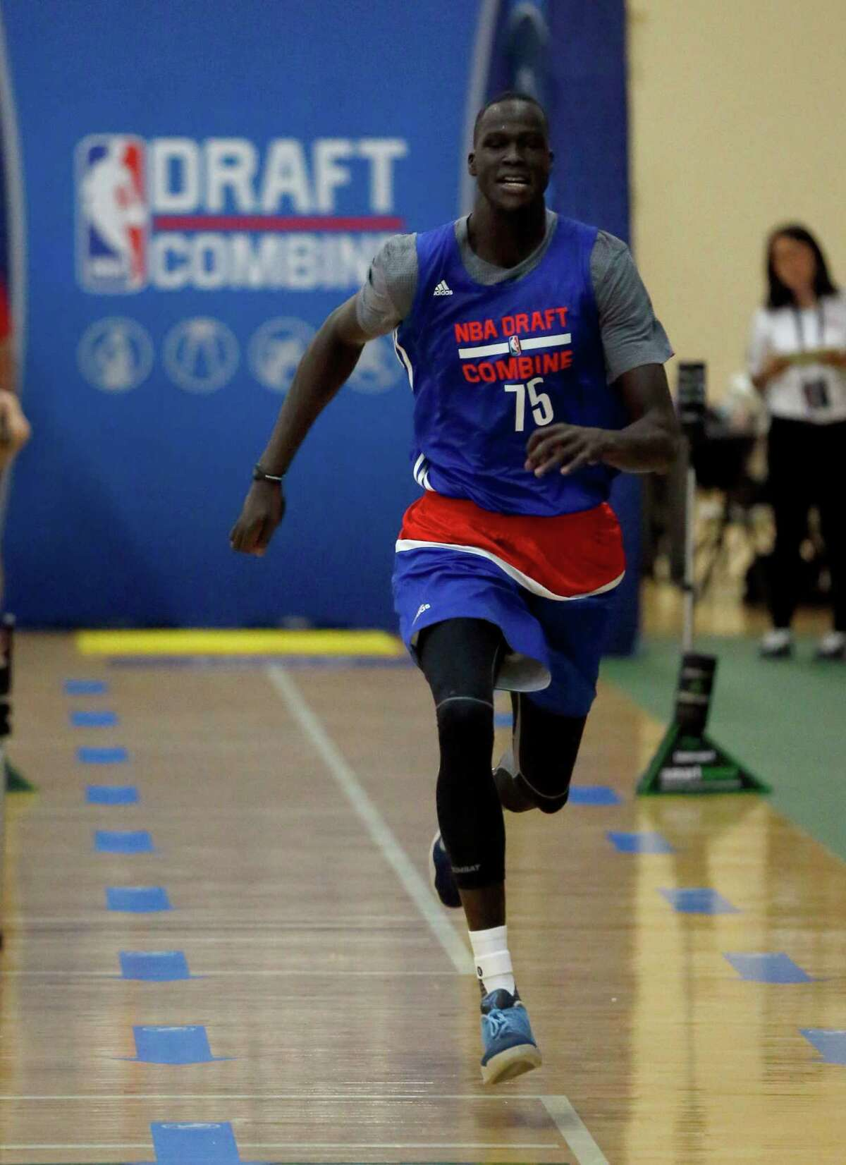 Thon Maker, from Orangeville Prep-Athlete Institute, participates in the NBA draft basketball combine Friday, May 13, 2016, in Chicago. (AP Photo/Charles Rex Arbogast)