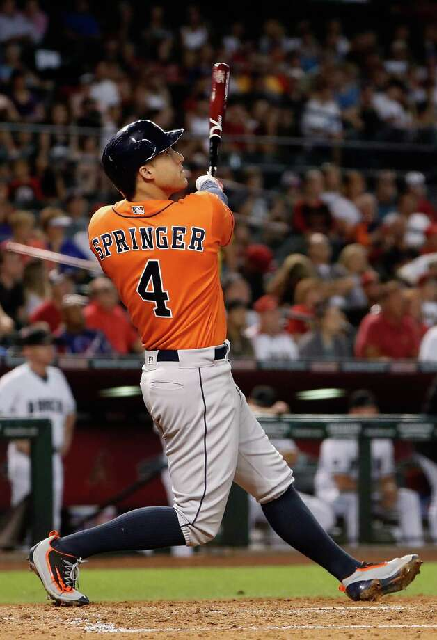 George Springer keeps his eyes on the ball as it heads over the right-field fence for a second-inning homer Tuesday. Batting leadoff over the last eight games, he has hit .457, and the Astros have gone 7-1. Photo: Christian Petersen, Staff / 2016 Getty Images