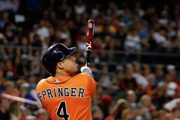 George Springer keeps his eyes on the ball as it heads over the right-field fence for a second-inning homer Tuesday. Batting leadoff over the last eight games, he has hit .457, and the Astros have gone 7-1.