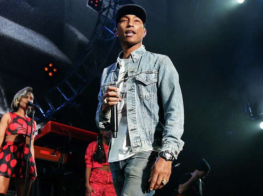 Pharrell Williams is among the stars who have signed letters asking for changes to copyright law. The music industry has a strained relationship with YouTube. Photo: John Salangsang, INVL / Invision