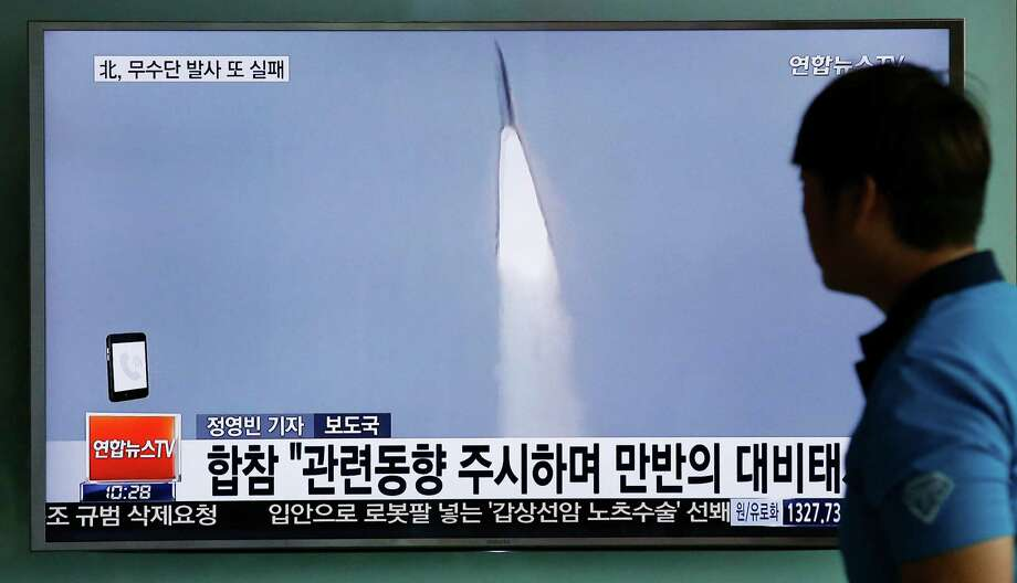 """A man watches a TV news program reporting about a missile launch of North Korea, at the Seoul Train Station in Seoul, South Korea, Tuesday, May 31, 2016. A North Korean missile launch likely failed on Tuesday, according to South Korea's military, the latest in a string of high-profile failures that tempers somewhat recent worries that Pyongyang was pushing quickly toward its goal of a nuclear-tipped missile that can reach America's mainland. The letters read on top left, """"Fail, North Korea's Musudan missile."""" (AP Photo/Lee Jin-man) Photo: Lee Jin-man, STF / Copyright 2016 The Associated Press. All rights reserved. This material may not be published, broadcast, rewritten or redistribu"""
