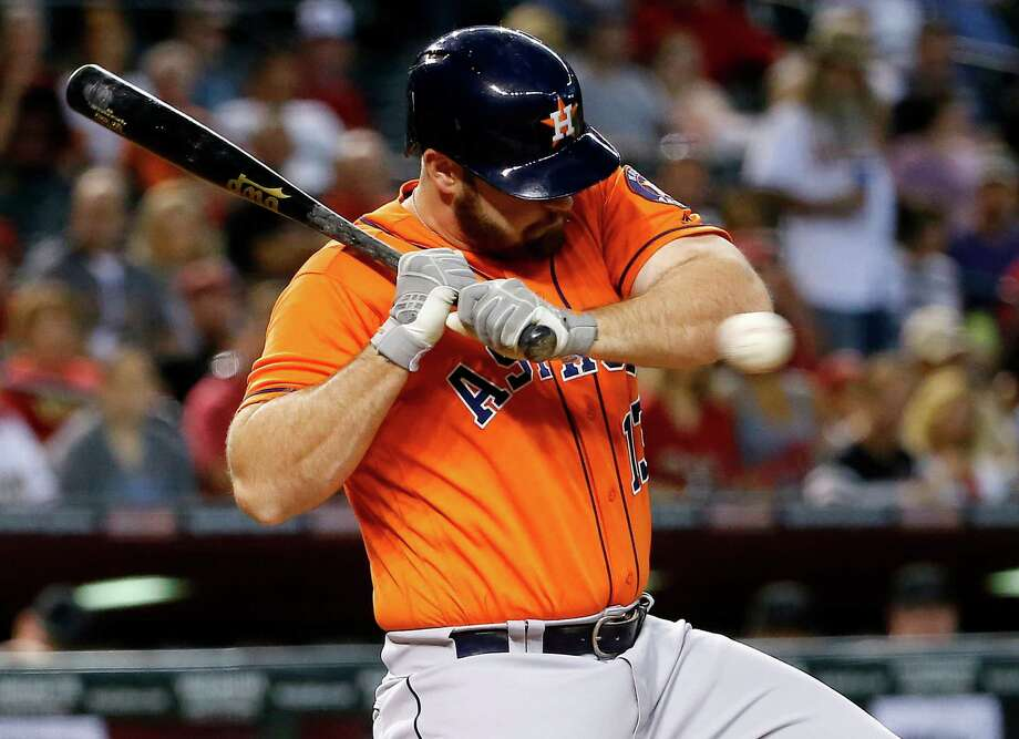 The Astros' Evan Gattis manages to avoid a high and tight pitch in the first inning Tuesday. Photo: Matt York, STF / Copyright 2016 The Associated Press. All rights reserved. This material may not be published, broadcast, rewritten or redistribu
