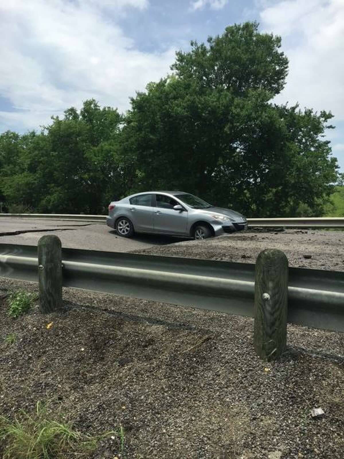 Over the weekend, 11 vehicles have forced their way through the barrier on SH 21 near FM 2001 in Hays County and got stuck in the collapsed roadway.