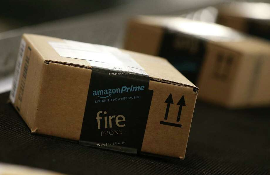 Online retailer Amazon already operates at least six distribution centers in the state, including one in Houston. A new one is planned for San Marcos.  Photo: Justin Sullivan, Staff / 2015 Getty Images