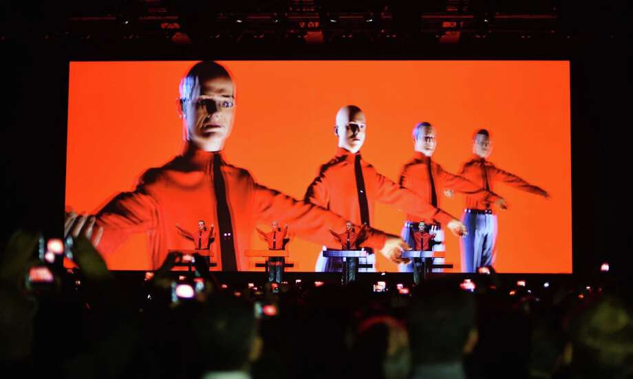 """Dummies stand on stage as German electronic music pioneers Kraftwerk perform  in Berlin in 2015. The group lost a court decision in Germany Tuesday over a music producer's sampling from a 1977 work, """"Metall auf Metall."""" Photo: Jens Kalaene, SUB / dpa"""