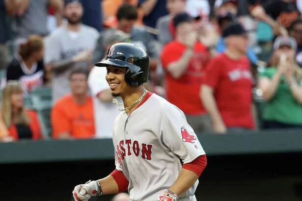 BALTIMORE, MD - MAY 31: Mookie Betts #50 of the Boston Red Sox smiles while running to home after hitting a three RBI home run against the Baltimore Orioles in the second inning at Oriole Park at Camden Yards on May 31, 2016 in Baltimore, Maryland.  (Photo by Rob Carr/Getty Images) ORG XMIT: 607678621
