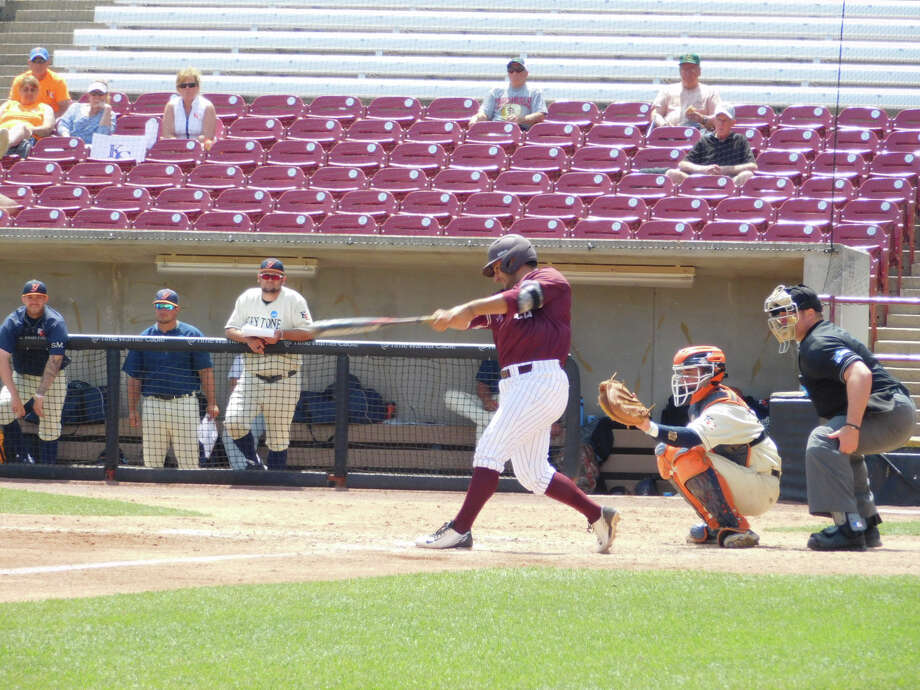Trinity designated hitter Jose Santos hits a double in Game 1 of Tuesday's DIII Championship game. Photo: Dennis Wilson, For The Express-News