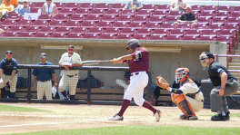 Trinity designated hitter Jose Santos hits a double in Game 1 of Tuesday's DIII Championship game.