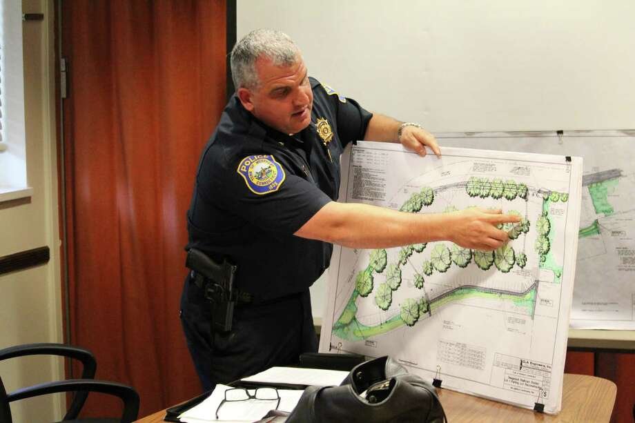 Police Chief Foti Koskinas explains to Kristan Hamlin, RTM District 4, the scope of the $1.5 million renovation to take place at Lot 1 of the Westport train station. Photo: Chris Marquette / Hearst Connecticut Media / Westport News