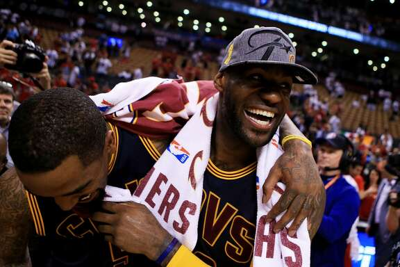 TORONTO, ON - MAY 27:  LeBron James #23 and J.R. Smith #5 of the Cleveland Cavaliers celebrate their 113 to 87 win over the Toronto Raptors in game six of the Eastern Conference Finals during the 2016 NBA Playoffs at Air Canada Centre on May 27, 2016 in Toronto, Canada. NOTE TO USER: User expressly acknowledges and agrees that, by downloading and or using this photograph, User is consenting to the terms and conditions of the Getty Images License Agreement.  (Photo by Vaughn Ridley/Getty Images)