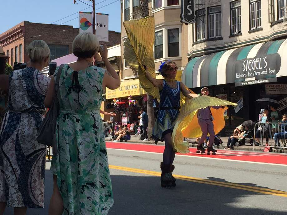 Bystanders take video of San Francisco's Carnaval Parade on May 28, 2016. Photo: Amy Graff