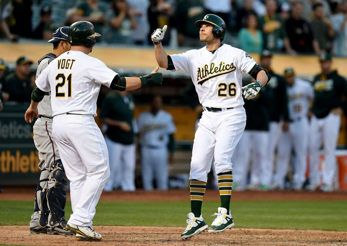 The Oakland Athletics' Danny Valencia (26) celebrates his two-run home run, bringing home Stephen Vogt (21), against the Minnesota Twins in the third inning at Oakland-Alameda Coliseum in Oakland, Calif., on Tuesday, May 31, 2016. (Susan Tripp Pollard/Bay Area News Group/TNS)