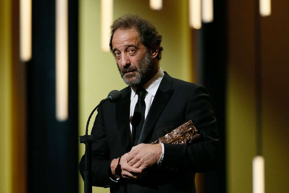 """French actor Vincent Lindon delivers a speech after he won the Best Actor award for """"La Loi du Marche (The Measure of a Man)"""" during the 41st edition of the Cesar Ceremony at the Theatre du Chatelet in Paris on February 26, 2016.    AFP PHOTO / PATRICK KOVARIKPATRICK KOVARIK/AFP/Getty Images Photo: PATRICK KOVARIK, AFP/Getty Images"""