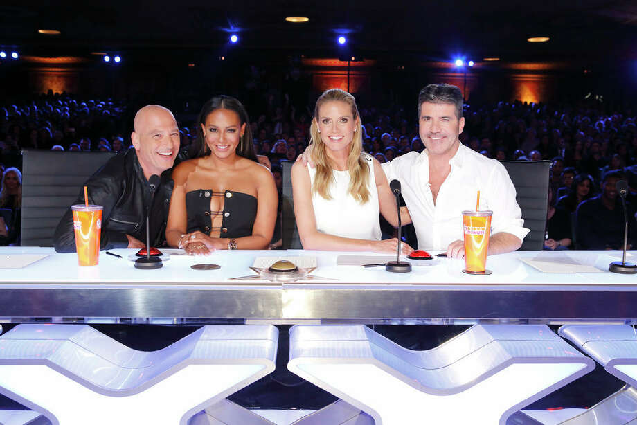 AMERICA'S GOT TALENTjudges -- Howie Mandel, Mel B, Heidi Klum, Simon Cowell -- let loose their top picks by pressing the Golden Buzzer.  Photo: NBC, Trae Patton/NBC / 2016 NBCUniversal Media, LLC