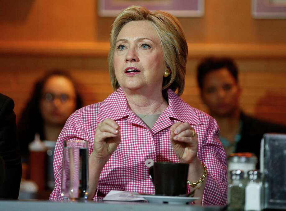 Hillary Clinton has a 45 - 41 percent lead over Republican Donald Trump in the race for president, according to a Quinnipiac University National poll released Wednesday, June 1, 2016. When third party candidates are added to the mix, Clinton gets 40 percent with Trump at 38 percent, too close to call, the poll found. Photo: John Locher / Associated Press / Copyright 2016 The Associated Press. All rights reserved. This material may not be published, broadcast, rewritten or redistribu