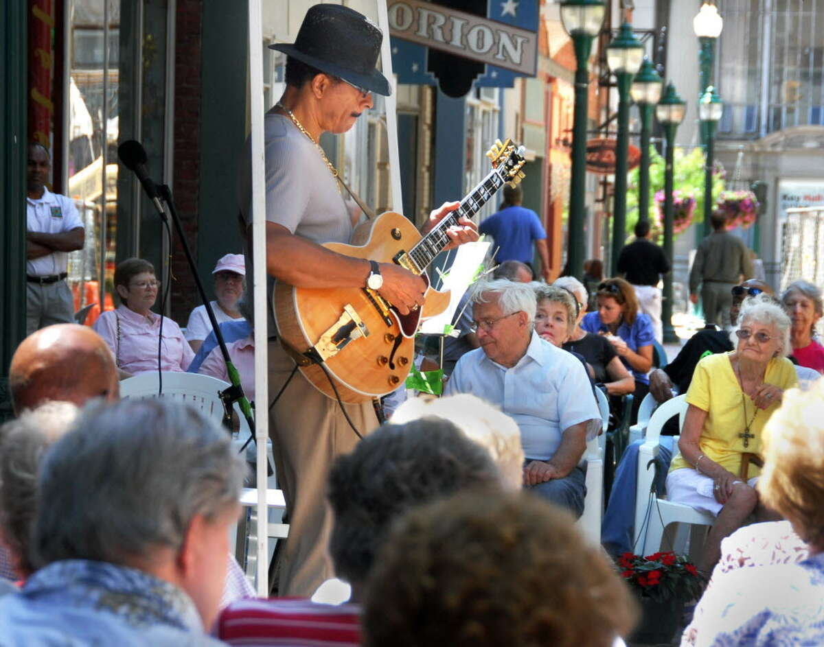 Jazz guitarist John McIntosh performs for a crowd gathered on the Jay St. pedestrian mall for Jazz on Jay Thursday afternoon July 29, 2010. (John Carl D'Annibale / Times Union)