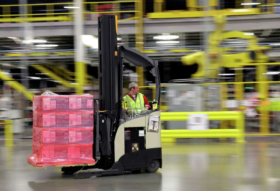 A forklift operator moves a pallet of goods at an Amazon.com fulfillment center in DuPont, Wash. in this Feb. 13, 2015, file photo. The online retail giant is hiring fulfillment associates, software developer managers, senior financial analysts and human resources managers among other positions for its San Marcos center. Photo: File Photo /AP / AP