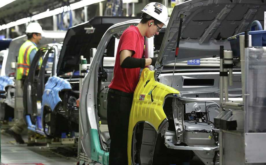 Workers at the Toyota Motor Manufacturing Texas plant in San Antonio work on Tacoma bodies. The midsize pickup truck — which is also built at a plant in Baja California, Mexico — will be built in a third facility starting in 2020, when the new facility will open in Guanajuato, Mexico. Photo: San Antonio Express-News File Photo / San Antonio Express-News