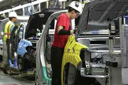 Toyota employees work on pickup trucks at the San Antonio facility in this 2015 photo.