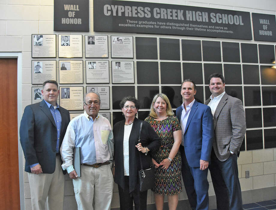 The Cypress Creek High School Wall of Honor class of 2016 stands in front of the wall at the school after being inducted May 18. From left are Lt. Col. Jason Colbert; Gerry and Leigh Mercado, parents of inductee Yehudi Mercado; Dr. Courtney Robertson; Dr. Kevin Beam; and T.J. Farnsworth.